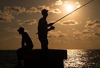 HAVANA, CUBA - CIRCA MAY 2016:  Man fishing from the Malecon in Havana, Cuba.