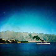 The TSS Earnslaw, the 100 year old vintage coal fired passenger steam ship sails on Lake Wakatipu, Queenstown, New Zealand. The popular tourist attraction is celebrating it's centenary year with celebrations planned for October 2012.  Queenstown, Central Otago, New Zealand. 29th February 2012. Photo Tim Clayton