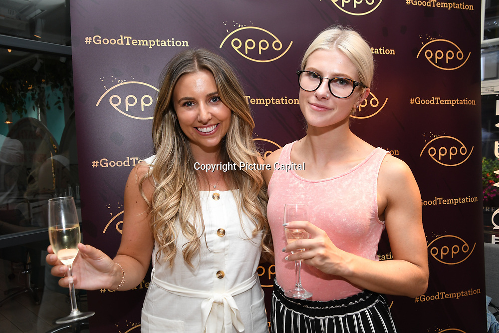 Frankie Jackson-Spence @FJSFIT & Corina Jones @corriefitnessuk attend the Oppo party to launch its new Madagascan Vanilla, Sicilian Lemon and Raspberry Cheesecakes, served with Skinny Prosecco at Farm Girls Café, 1 Carnaby Street, Soho, London, UK on July 18 2018.