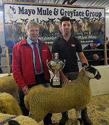 TJ Gormally from Cormac Tagging with the Best in Show Prize winner John Morahan Kilmaine Co Mayo with his Hoggets at Mayo Mule and Greyface Sale 24th August 2018 Ballinrobe.<br /> Pic Conor McKeown