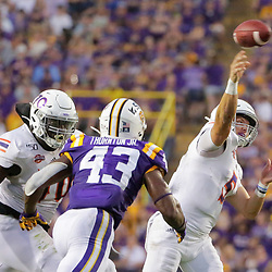 Sep 14, 2019; Baton Rouge, LA, USA; Northwestern State Demons quarterback Shelton Eppler (5) throws a touchdown against the LSU Tigers during the first quarter at Tiger Stadium. Mandatory Credit: Derick E. Hingle-USA TODAY Sports