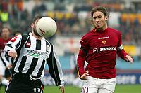 Roma 22/2/2004 <br />Roma Siena 6-0 <br />Nikola Lazetic (Siena) defends on Francesco Totti (Roma) <br />Photo Andrea Staccioli Graffiti