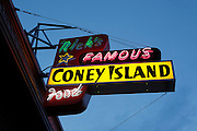 "A classic sign for ""Nicks Famous Coney Island Food"" on Hawthorne street, a shopping district in SE Portland, Oregon."