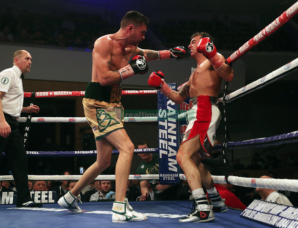 Tyrone McKenna and Jake Hanney during Super Light Weight bout at Belfast Waterfront.