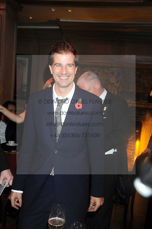 JAMIE POULTON at a party to celebrate the launch of Hollywood Domino - a brand new board game, held at Mosimann's 11b West Halkin Street, London on 7th November 2008.  The evening was in aid of Charlize Theron's Africa Outreach Project.