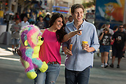 A couple enjoys the Midway at the State Fair of Texas.