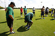 Monday, July 8, 2013 REGGIE WILLIAMS : Former Cincinnati Bengals player and Cincinnati City Councilman Reggie Williams, center goes back to his old stomping grounds at the ESPN Wide World of Sports Complex on the Walt Disney property. He was greeted by old friends and had a chance to see some NFL players and hopefuls workout. Reggie has to stretch throughout the day to keep mobile due to his many surgical procedures. <br /> He helped build the complex from the ground up and was one of Disney's first African American executives.  The Enquirer/Jeff Swinger