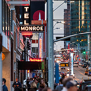 Vertical photo of crowded city street; sidewalk and road traffic; Main Street, downtown Kansas City, Missouri.