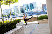 UNITED KINGDOM, London: 05 May 2020 <br /> Sophia Lunt, aged 22, carries out her exercises in a secluded area along Three Quays Walk by the Tower of London this afternoon. Many have resorted to exercising in public spaces after gyms were shut due to the coronavirus pandemic sweeping the nation.