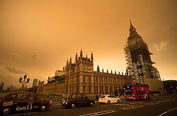 © Licensed to London News Pictures. 16/10/2017. London, UK. The sky over central London is turned orange as the remains of Hurricane Ophelia whips up dust from the Sahara desert. 80 mph winds and storm conditions have hit Ireland already today. Photo credit: Peter Macdiarmid/LNP