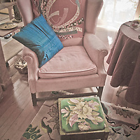 An old fashioned home interior with armchair