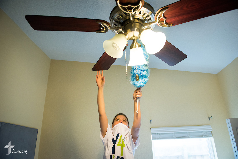 Y4Life student volunteer Krystal Hansen cleans a ceiling fan at Redeeming Life Maternity Home during a servant event on Saturday, Sept. 12, 2015, in Sanford, Fla. LCMS Communications/Erik M. Lunsford