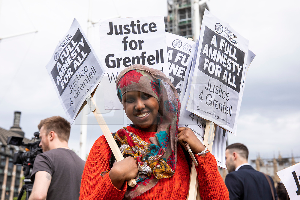 © Licensed to London News Pictures. 14/05/2018. London, UK. People protest in Parliament Square to mark eleven months since the Grenfell Tower Fire in which 71 people were killed. Photo credit: Rob Pinney/LNP