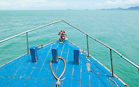 The bow of a ferry boat in the gulf of Thailand heading from Ko Samui to Ko Phangnan.  Flowers and fruit sit at the point&#xA;<br />