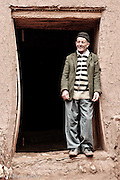 A caretaker stands in a doorway located in the fortified ksar of Ait Benhaddou.