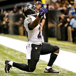 Nov 24, 2014; New Orleans, LA, USA; Baltimore Ravens running back Justin Forsett (29) celebrates after scoring a touchdown against the New Orleans Saints during the second quarter of a game at the Mercedes-Benz Superdome. Mandatory Credit: Derick E. Hingle-USA TODAY Sports
