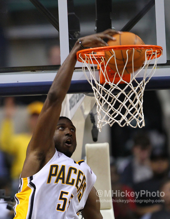 April 10, 2011; Indianapolis, IN, USA; Indiana Pacers center Roy Hibbert (55) dunks the ball against the New York Knicks at Conseco Fieldhouse. Mandatory credit: Michael Hickey-US PRESSWIRE