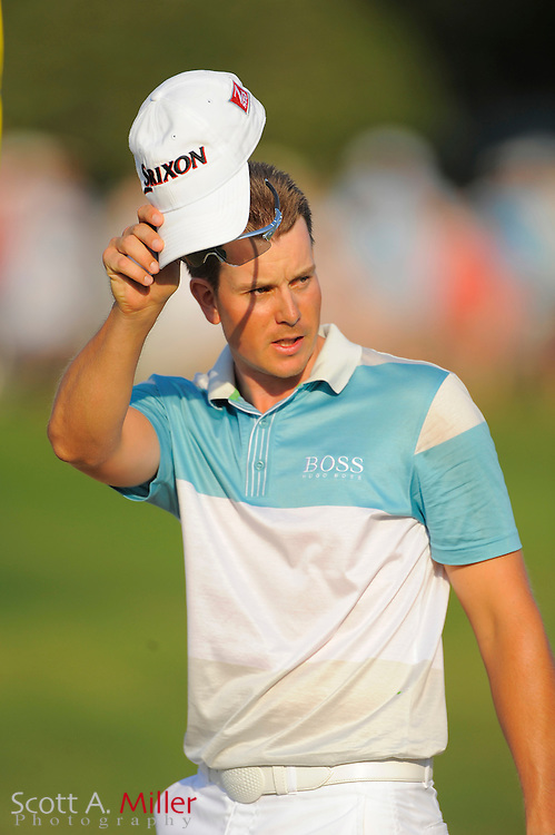 Henrik Stenson of Sweden tips his cap to the gallery after winning the Players Championship at TPC Sawgrass on May 10, 2009 in Ponte Vedra Beach, Florida.     ©2009 Scott A. Miller