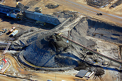 CANADA ALBERTA FORT MCMURRAY 10MAY07 - Aerial view of Suncor crusher and transport facility north of Fort McMurray, Alberta, Canada. The Alberta Tar Sands are the largest deposits of their kind in the world and their production is the single largest contributor to Canada's greenhouse gas emissions...Alberta's tar sands are currently estimated to contain a crude bitumen resource of 315 billion barrels, with remaining established reserves of almost 174 billion barrels, thus making Canada's oil resources ranked second largest in the world in terms of size...The industry has brought wealth and an economic boom to the region but also created an environmental disaster downstream from the Athabasca river, polluting the lakes where water and fish are contaminated. The native Indian tribes of the Mikisew, Cree, Dene and other smaller First Nations are seeing their natural habitat destroyed and are largely powerless to stop or slow down the rapid expansion of the oil sands development, Canada's number one economic driver...jre/Photo by Jiri Rezac / WWF-UK..© Jiri Rezac 2007..Contact: +44 (0) 7050 110 417.Mobile: +44 (0) 7801 337 683.Office: +44 (0) 20 8968 9635..Email: jiri@jirirezac.com.Web: www.jirirezac.com..© All images Jiri Rezac 2007 - All rights reserved.