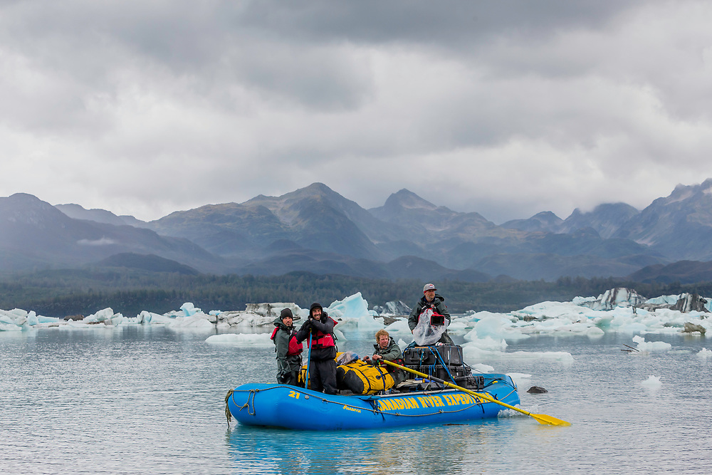 Camera and production team along with their guide Brad Goodwin film while they paddle through the Alsek Lake in the Tatshenshini-Alsek Provincial Park in British Columbia, Canada on September 8, 2016.