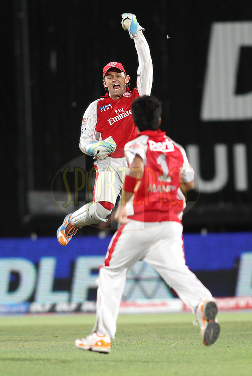 Captain Adam Gilchrist of the Kings XI Punjab celebrates after catching Chris Gayle of the Royal Challengers Bangalore during match 63 of the Indian Premier League ( IPL ) Season 4 between the Kings XI Punjab and the Royal Challengers Bangalore held at the The HPCA Stadium in Dharamsala, Himachal Pradesh, India on the 17th May 2011..Photo by Shaun Roy/BCCI/SPORTZPICS
