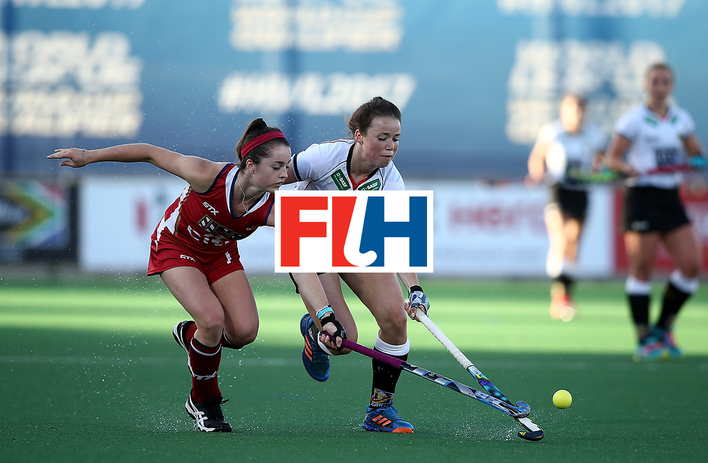JOHANNESBURG, SOUTH AFRICA - JULY 23:  Amelie Wortmann of Germany battles with Erin Matson of United States of America during day 9 of the FIH Hockey World League Women's Semi Finals final match between X at Wits University on July 23, 2017 in Johannesburg, South Africa.  (Photo by Jan Kruger/Getty Images for FIH)