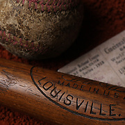 An antique vintage baseball, baseball bat, and used ticket stub. 7th June 2012. Photo Tim Clayton