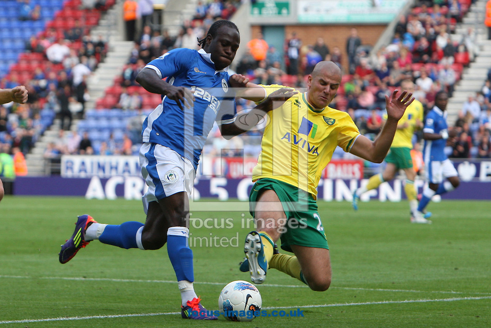 Adam Drury of Norwich and Victor Moses of Wigan Athletic in action during the Barclays Premier League match at the DW Stadium, Wigan...Picture by Paul Chesterton/Focus Images Ltd. .07904 640267.13/8/11
