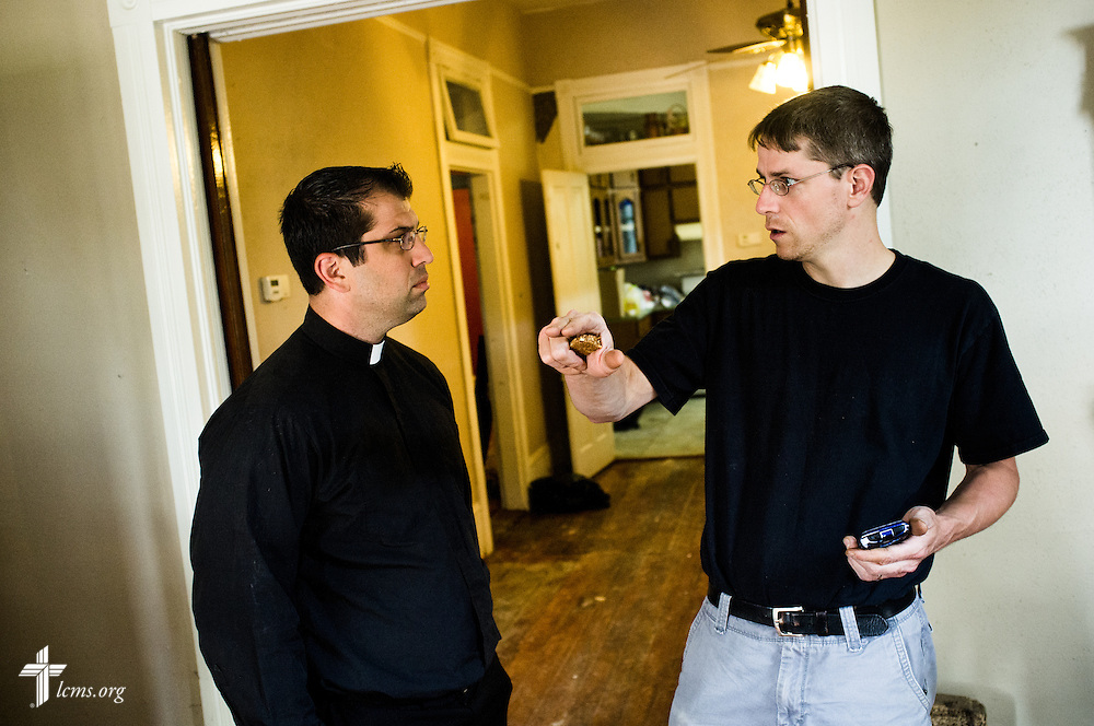 The Rev. Ross Johnson, director of LCMS Disaster Response, talks to Aaron Schneier and Pueschel Studstill Schneier (not pictured) on Saturday, May 3, 2014, in Pensacola, Fla., about the flood the family endured in their home from a recent torrential rainfall. LCMS Communications/Erik M. Lunsford