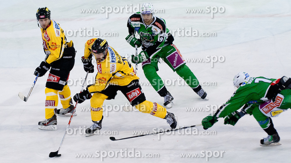 Dan Bjornlie (UPC Vienna Capitals, #28) vs Matej Hocevar (HDD Tilia Olimpija, #14) and Ziga Pance (HDD Tilia Olimpija, #19) during ice-hockey match between HDD Tilia Olimpija and UPC Vienna Capitals in 31st Round of EBEL league, on December 11, 2011 at Hala Tivoli, Ljubljana, Slovenia. (Photo By Matic Klansek Velej / Sportida)