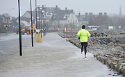 26/01/2016 Man out jogging in the flooding in Salthill in storm Jonas hits the West coast. Photo:Andrew Downes, XPOSURE .Photo:Andrew Downes