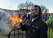 Chris Hicks, a grad student studying graphic design, poses in front of the bonfire during the Brand Launch event held on Manchester Field on Monday, Feb 1, 2016.