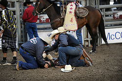 Bud Williamson from Queensland, Australia lies motionless after being knocked unconscious while still on Ferdinand in the second round of Wednesday's 2013 PBR Touring Pro Division event at the Salinas Sports Complex.