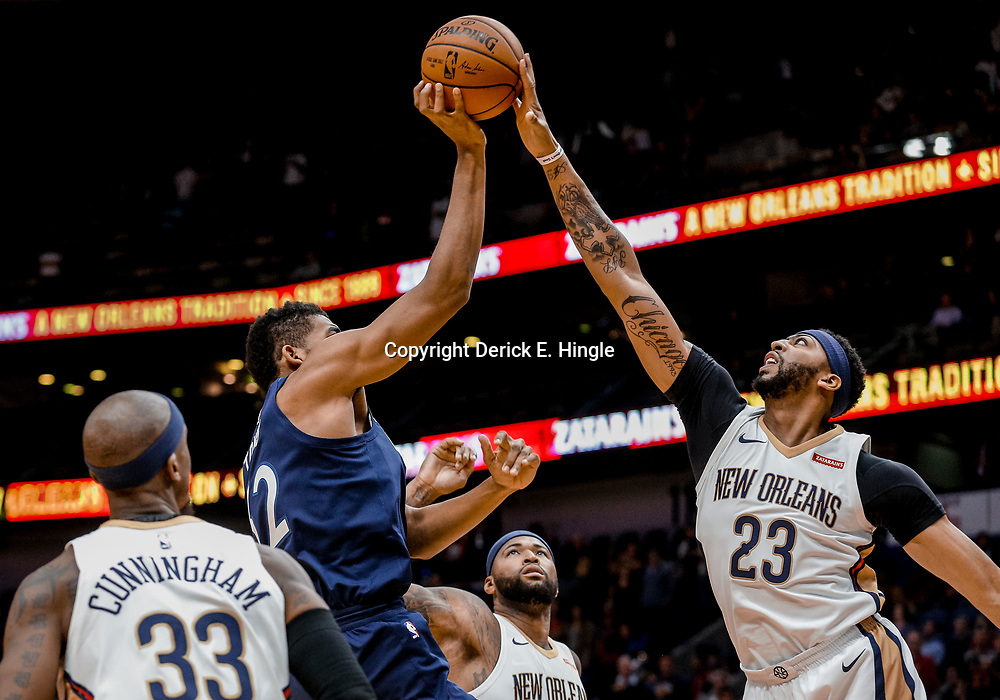Nov 1, 2017; New Orleans, LA, USA; New Orleans Pelicans forward Anthony Davis (23) blocks a shot by Minnesota Timberwolves center Karl-Anthony Towns (32) during the first quarter of a game at the Smoothie King Center. Mandatory Credit: Derick E. Hingle-USA TODAY Sports