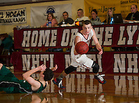 Hopkinton's Brian Hauschild hits the floor as Concord's Kaleb Marquis dribbles past during the semi final game during the Capitol Area Holiday Tournament at NHTI Saturday night.   (Karen Bobotas/for the Concord Monitor)