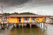 Kampong Ayer, or the Water Village (Malay: Kampong Ayer) is an area of Brunei's capital city Bandar Seri Begawan that is situated in the middle of the Brunei River. 39,000 people live in the Water Village. This represents roughly ten percent of the nation's total population. All of the Water Village buildings are constructed on stilts above the Brunei River. The Water Village is really made up of small villages linked together by more than 29,140 meters of foot-bridges, consisting of over 4200 structures including homes, mosques, restaurants, shops, schools, and a hospital.