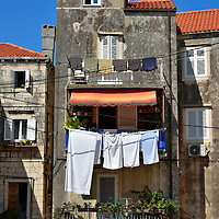 Laundry Hanging From Narrow House in Korčula, Croatia<br />