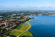Nederland, Noord-Holland, Gemeente Edam-Volendam, 13-06-2017; De Hulk, IJsselmeerdijk en Hoornsche Hop ten zuidwesten van Hoorn (aan de horizon).<br /> De dijk staat op de nominatie om verstrekt te worden, bewoners en actievoerders vrezen aantasting van de monumentale dijk en verlies culturele waarden.<br /> Former seawall and water of Hoornsche Hop, southwest of Hoorn.<br /> The dike is nominated to be reinforced, residents and activists fear losing the monumental quality of the dike and losing other cultural values.<br /> <br /> luchtfoto (toeslag op standaard tarieven);<br /> aerial photo (additional fee required);<br /> copyright foto/photo Siebe Swart