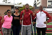 Mar 24, 2018; Los Angeles, CA, USA; Randall Cunningham Jr. (second from left) poses with mother Felicity Cunningham (second from right), father Randall Cunningham (right) and Southern California Trojans coach Caryl Smith-Gilbert during the Power 5 Trailblazer challenge at Cromwell Field.