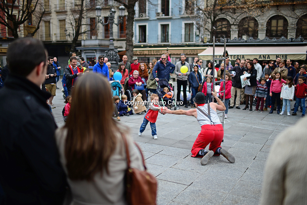 Clown performs in the center of Granada, Spain