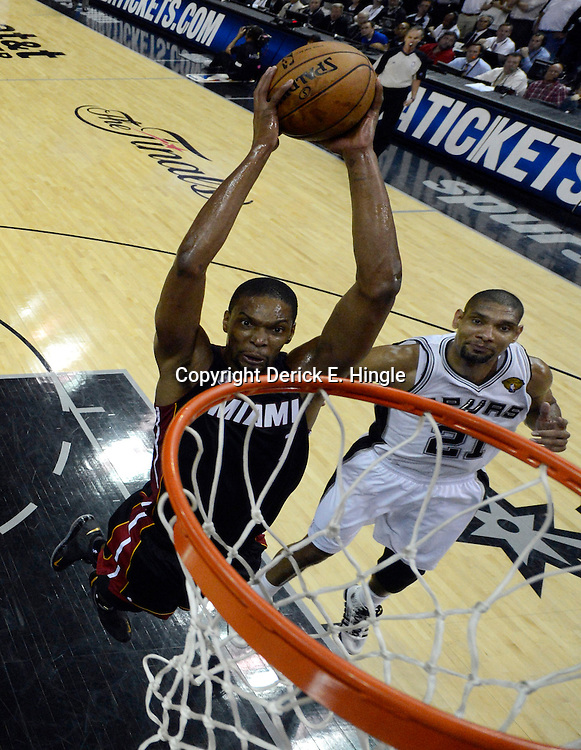 Jun 13, 2013; San Antonio, TX, USA; Miami Heat center Chris Bosh (1) dunks against the San Antonio Spurs during the first half of game four of the 2013 NBA Finals at the AT&T Center. Mandatory Credit: Derick E. Hingle-USA TODAY Sports