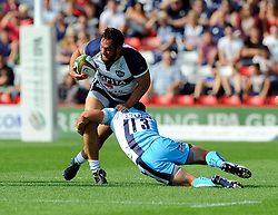 Worcester Outside Centre Alex Grove tackles Bristol Flanker Jack Lam - Photo mandatory by-line: Joe Meredith/JMP - Mobile: 07966 386802 - 7/09/14 - SPORT - RUGBY - Bristol - Ashton Gate - Bristol Rugby v Worcester Warriors - The Rugby Championship