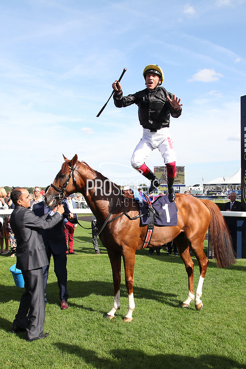 FRANKIE DETTORI celebrates with a FLYING DISMOUNT after winning The Group 2 Magners Rose Doncaster Cup Stakes over 2m 2f (£100,000) on STRADIVARIUS during the third day of the St Leger Festival at Doncaster Racecourse, Doncaster, United Kingdom on 13 September 2019.