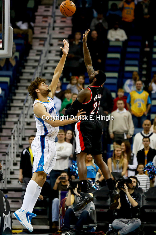 Feb 13, 2013; New Orleans, LA, USA; Portland Trail Blazers center J.J. Hickson (21) shoots over New Orleans Hornets center Robin Lopez (15) during the first quarter of a game at the New Orleans Arena. Mandatory Credit: Derick E. Hingle-USA TODAY Sports