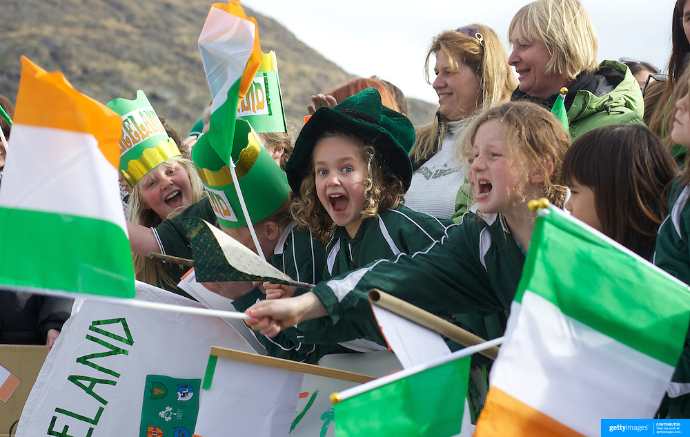 Milly Robinson, 8, (centre) with school mates from Tarras School near Wanaka greet  the Irish Rugby Team as they arrive at Queenstown airport for the IRB Rugby World Cup 2011, Queenstown, New Zealand, 1st September 2011. Photo Tim Clayton..