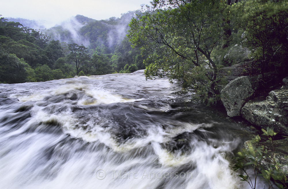 Fast flowing river above Upper National Falls, Royal National Park, Australia.