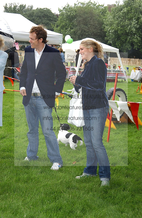 TOM PARKER BOWLES and LAURA PARKER BOWLES at the 3rd annual Macmillan Dog Day in aid of Macmillan Cancer Relief held at Royal Hospital Chelsea, London SW3 on 5th July 2005.<br />