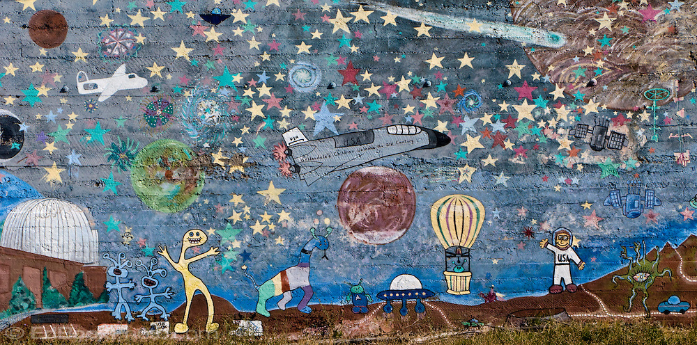 whimsical planetarium and space wall mural on a wall in