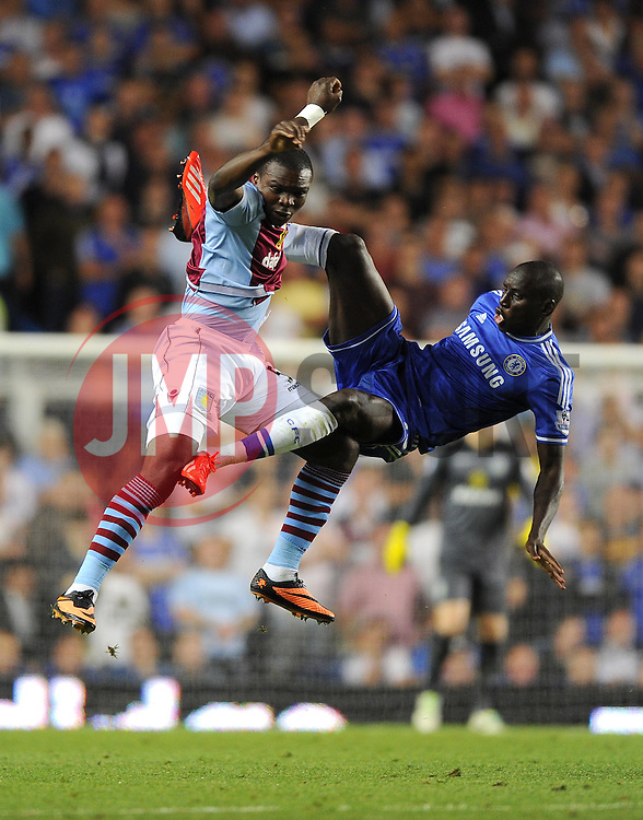 "Aston Villa's Jores Okore battles for the high ball with Chelsea's Demba Ba  - Photo mandatory by-line: Joe Meredith/JMP - Tel: Mobile: 07966 386802 21/08/2013 - SPORT - FOOTBALL - Stamford Bridge - London - Chelsea V Aston Villa - Barclays Premier League - EDITORIAL USE ONLY. No use with unauthorised audio, video, data, fixture lists, club/league logos or ""live"" services. Online in-match use limited to 45 images, no video emulation. No use in betting, games or single club/league/player publications"