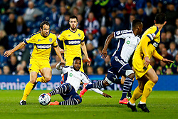 Johnny Mullins of Oxford United is challenged by Stephane Sessegnon of West Brom - Photo mandatory by-line: Rogan Thomson/JMP - 07966 386802 - 26/08/2014 - SPORT - FOOTBALL - The Hawthorns, West Bromwich - West Bromwich Albion v Oxford United - Capital One Cup Round 2.